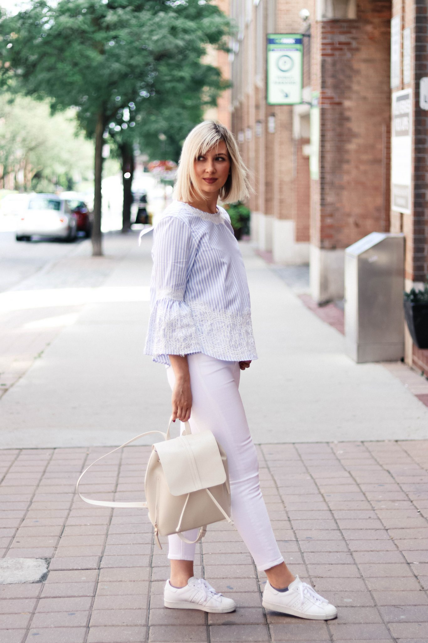 bell sleeves top and white jeans style