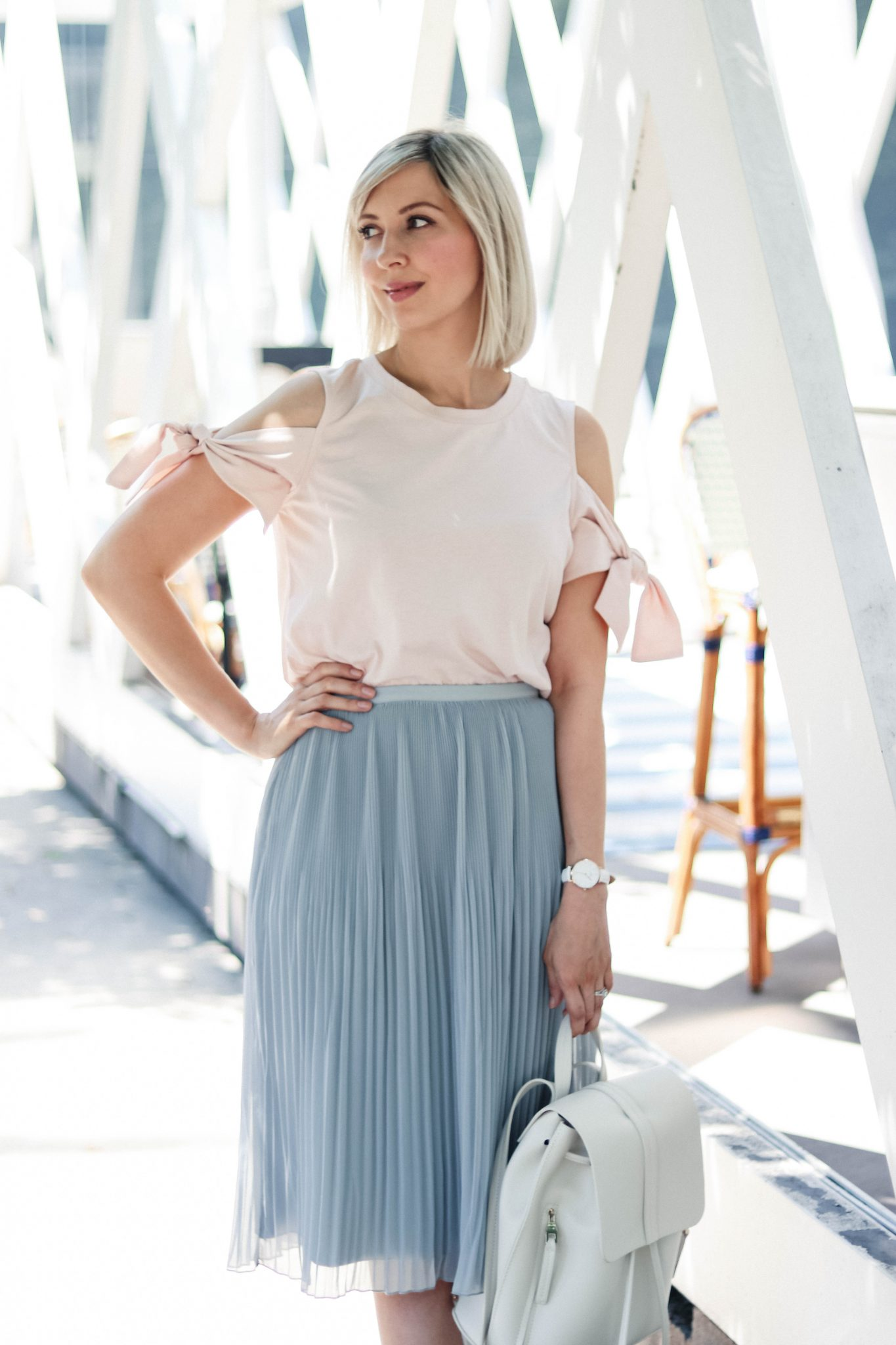 cold shoulder top and pleated skirt style