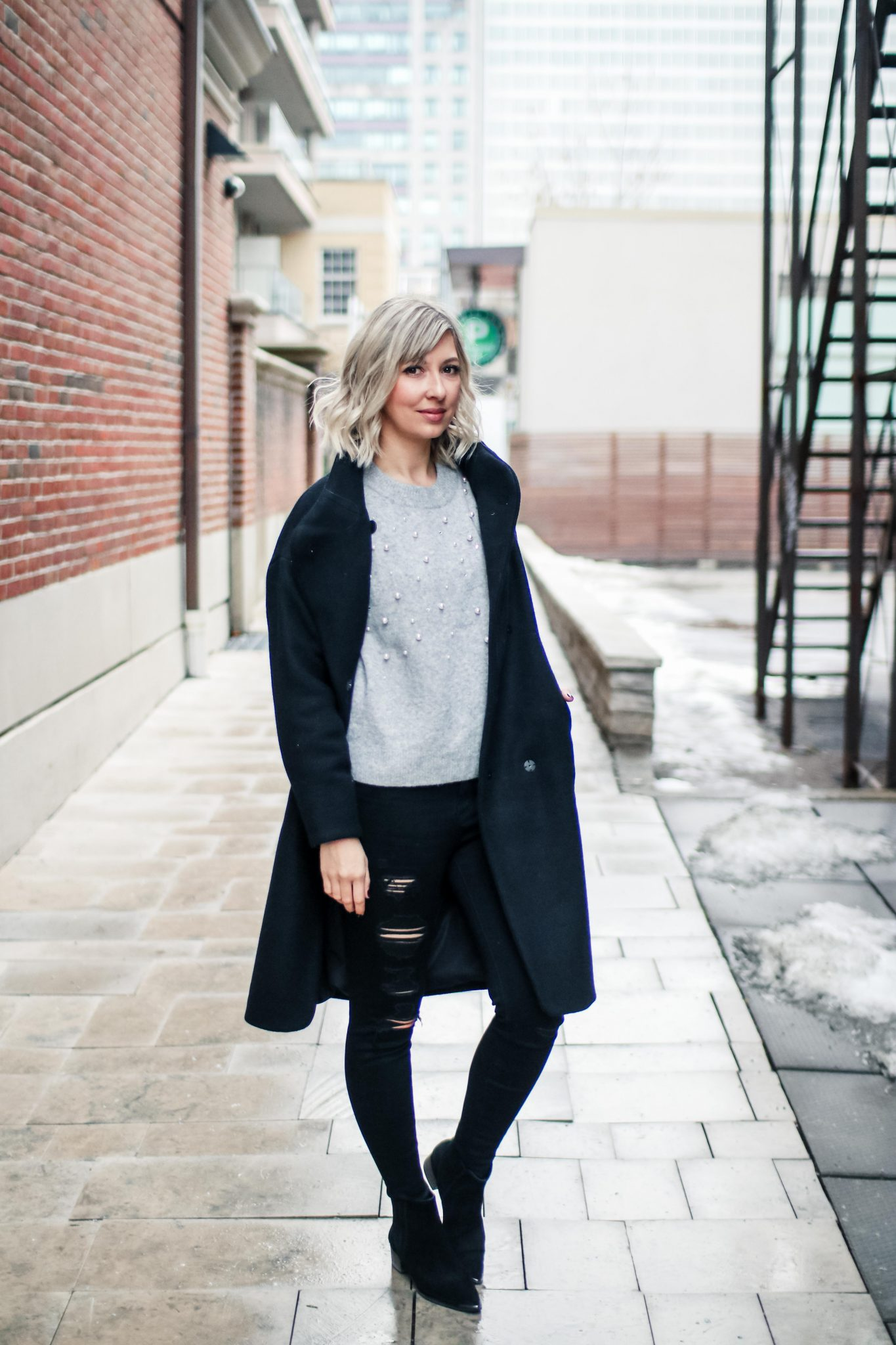 beaded sweater, black coat & distressed jeans 2