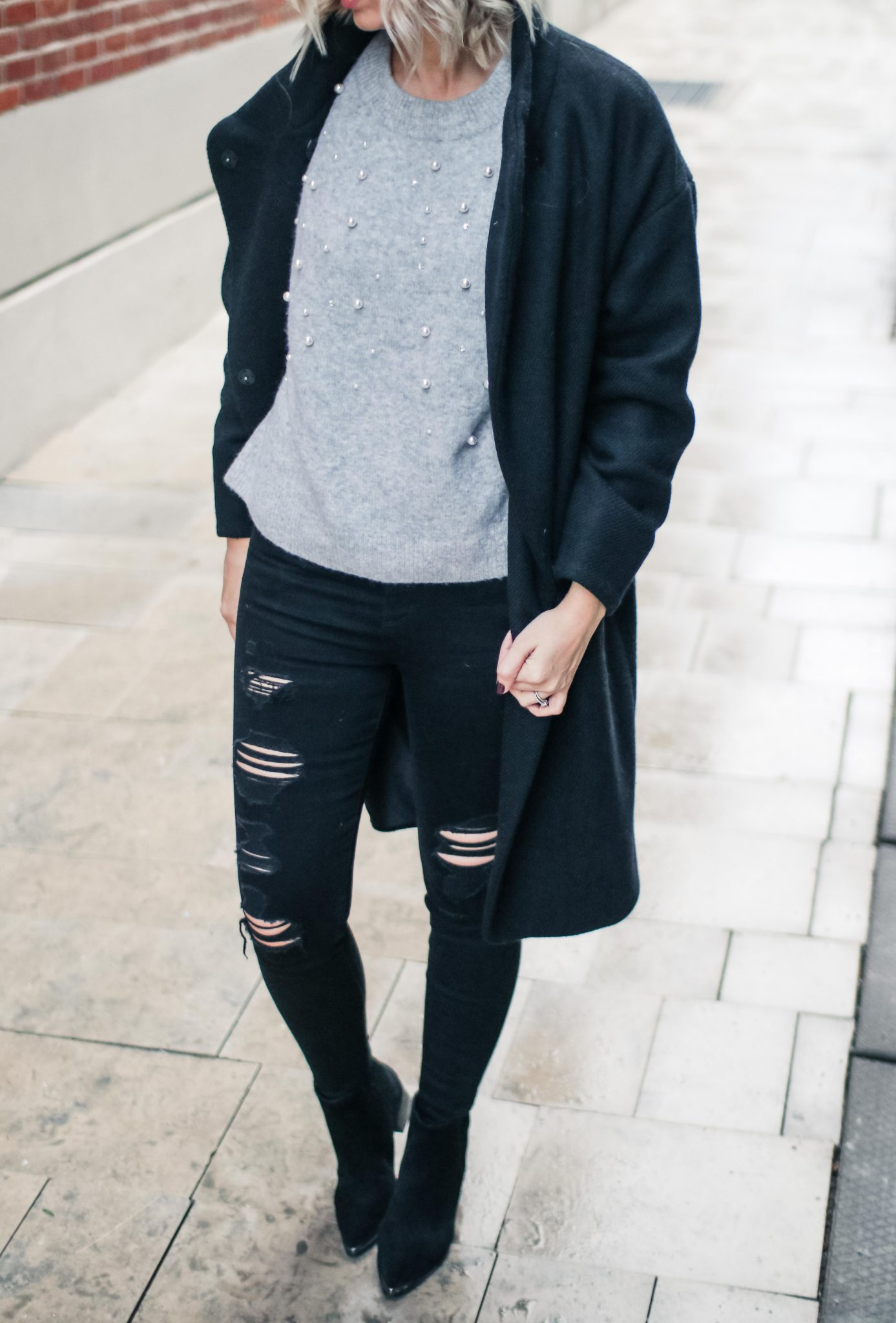 beaded sweater, black coat & distressed jeans 1