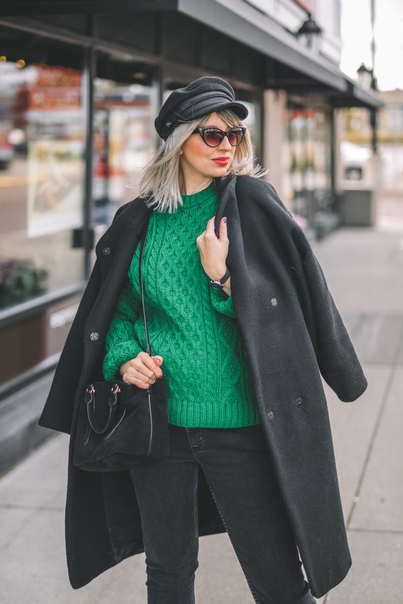 oversize coat, green knitted sweater, baker boy hat style 9