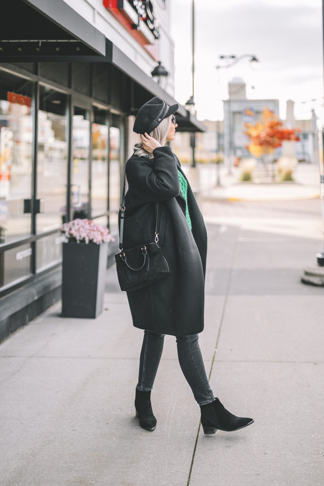 oversize coat, green knitted sweater, baker boy hat style 2
